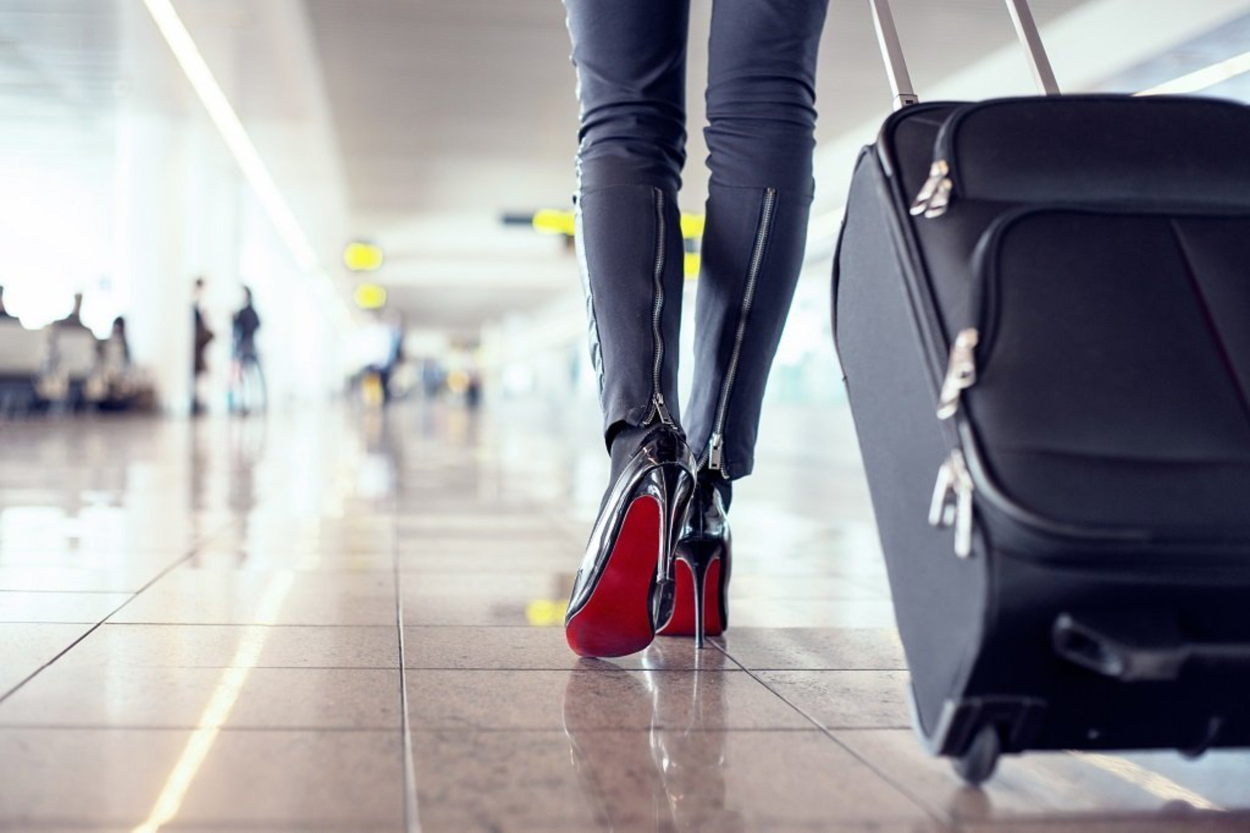 Red-Bottom-Shoes-Walking-Airport - Bisset-Holland