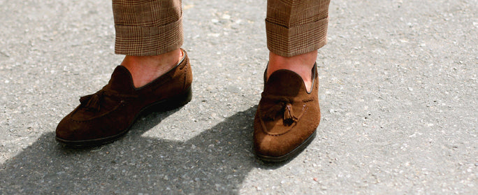 cuffed trousers and loafers with no socks