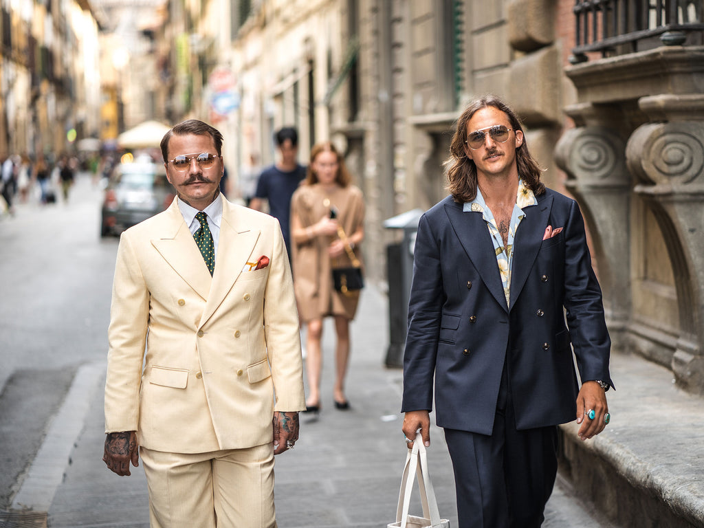 suited men on the street with tattoos