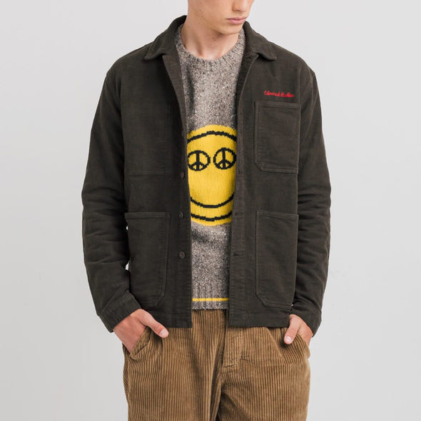 Brown shirt jacket with oversize pockets and embroidery on top of the left chest pocket.