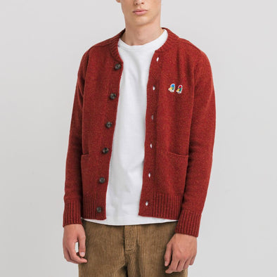 Red cardigan made with 100% wool and embroidery duck heads.