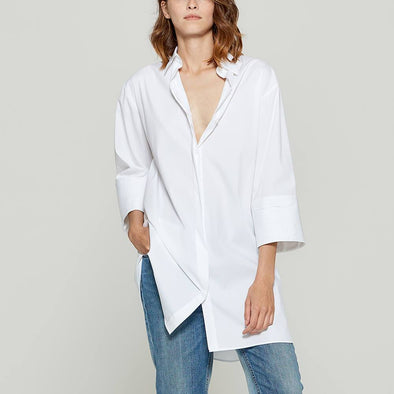 White overshirt with pleated details.