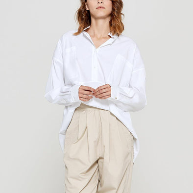 White mandarin collar blouse with two pockets.