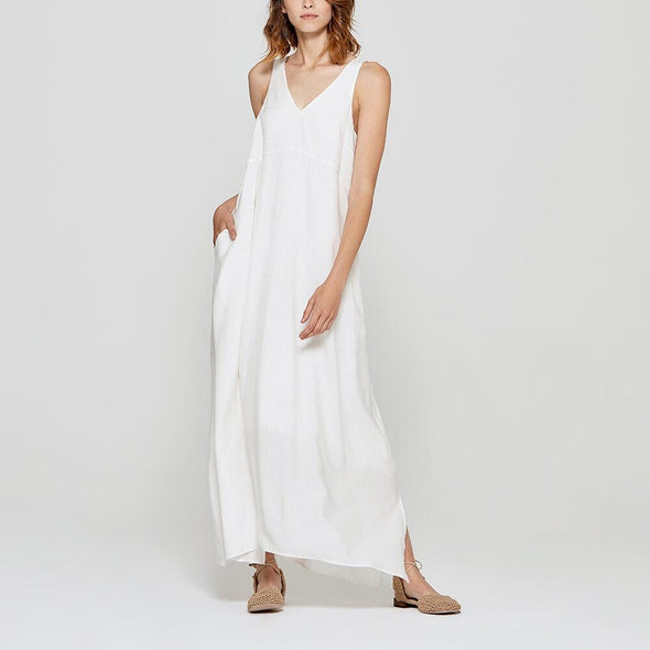 Long white flowy slip dress.