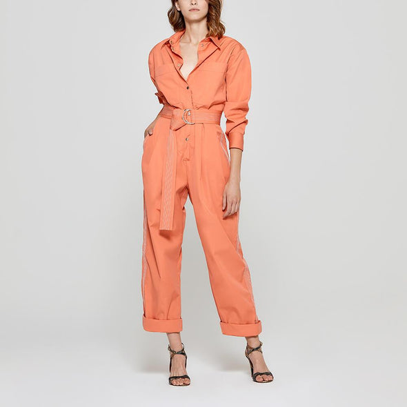 Orange jumpsuit with striped belt.