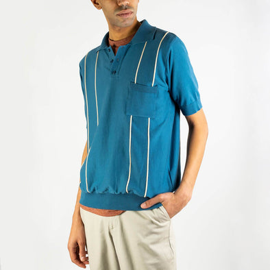 Blue light-medium weight polo-shirt with short sleeves and three-button placket.