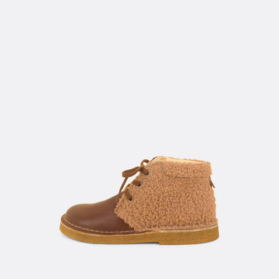 Kids' camel and brown desert boots with faux fur detail.
