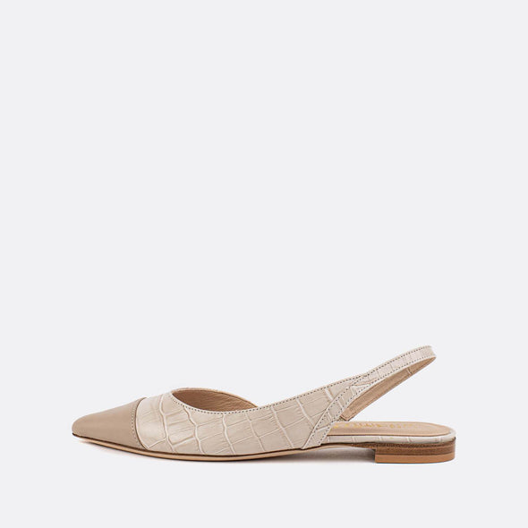 Beige texturized leather ballerinas with slip on strap at the ankle.