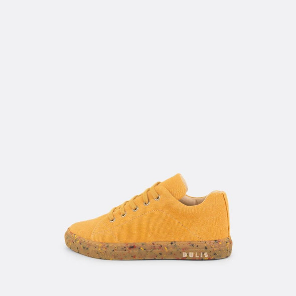 Kids' eco-friendly sneaker in yellow recycled cotton with recycled rubber sole and yellow laces.