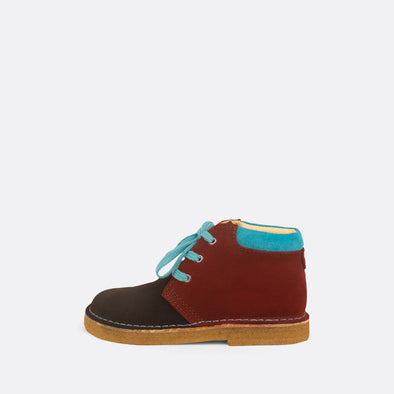 Kids' bordeaux desert boots with turquoise suede detail.