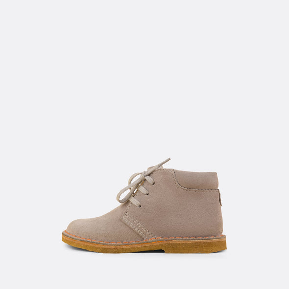 Kids' light grey desert boots with matching laces and rubber sole.