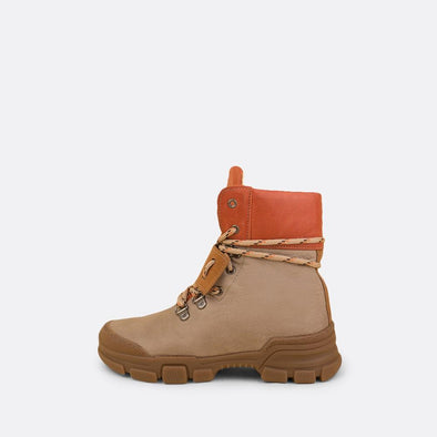 Kids' multi-color leather chunky boots with brown rubber track sole and mountain laces.