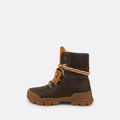 Kids' grey leather chunky boots with brown rubber track sole and mountain laces.