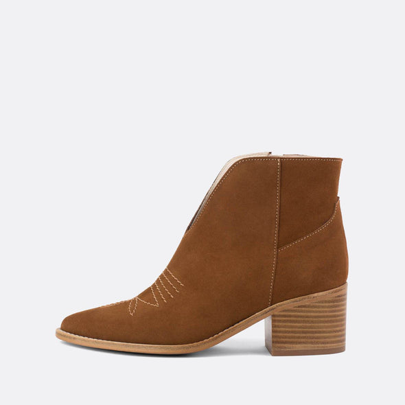 Camel crute ankle boots with wooden heel.
