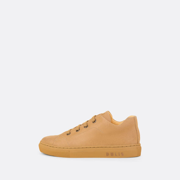 Kids' sneaker in camel leather with matching rubber sole and laces.