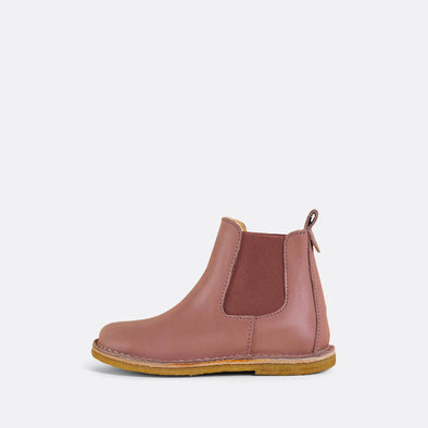 Kids' rose pink chelsea boots with natural rubber sole.