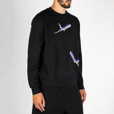 Black 100% premium cotton fleece, ribbed crewneck sweatshirt with embroidery placement of retro aeroplanes.