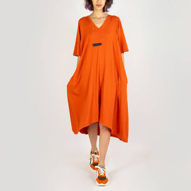 Comfortable midi dress in a tangerine colored stretchy material.