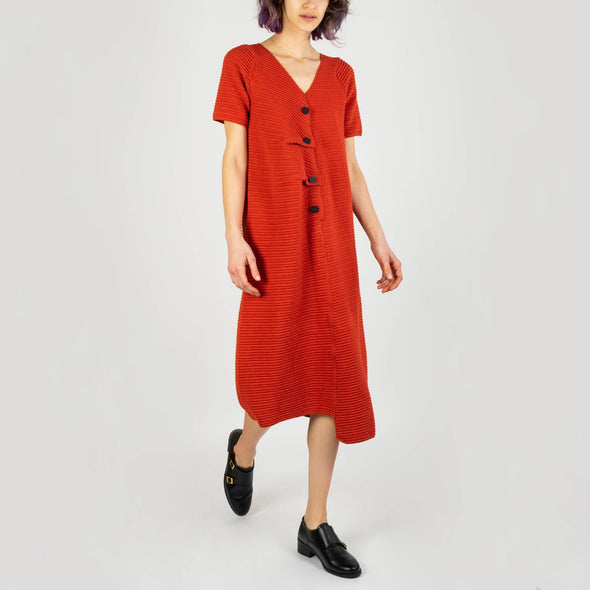 Comfortable scarlet midi dress with short sleeves and big black buttons.