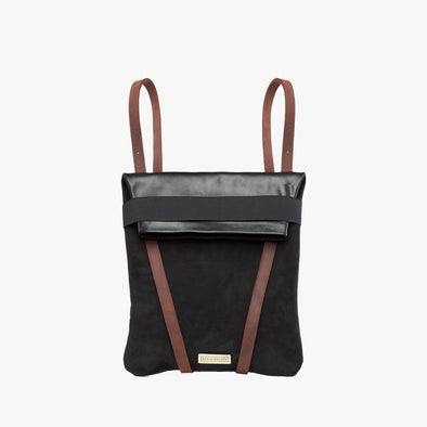 Faceted reversible backpack in black leather and black nubuck with fold-top, brown leather straps and elastic closure
