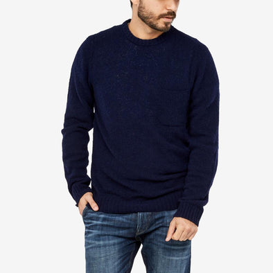 Classic jumper with chest pocket.