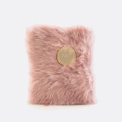 A6 notebook with 160 plain pages and pink furry leather cover.