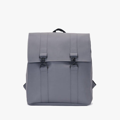 Boxy style minimalist backpack in grey synthetic with two black metallic hook clasps