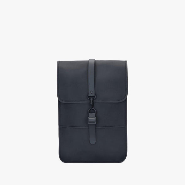 Boxy minimalist backpack in black synthetic with a single metallic black hook clasp