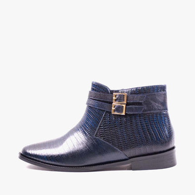 Chelsea boots in dark blue scale-embossed leather with a pointed toe and a double strap around the ankle