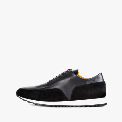 Minimalist lace-up runners in black leather with nubuck panels and white rubber sole