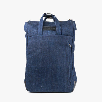 Rectangular backpack in dark blue denim with invisible exterior pocket and two handles