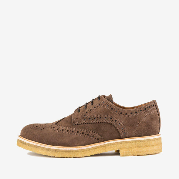 Derby shoes in brown suede with wingtip broguing and contrasting chunky crepe sole.