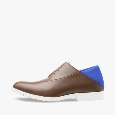 Lace-up derby shoes in brown leather with electric blue neoprene heel counter and white rubber track sole