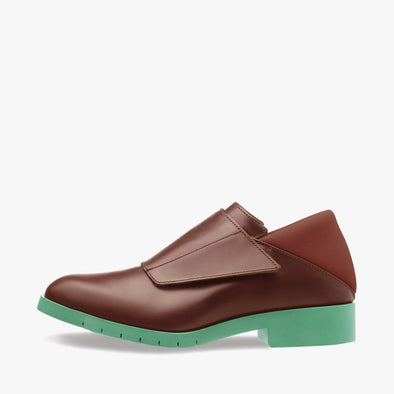 Monk shoes with a single velcro strap in brown leather with neoprene heel counter and contrasting mint green rubber track sole