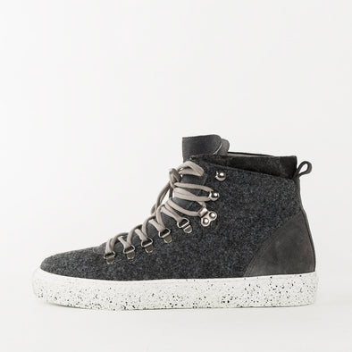 High top sneakers in grey suede, featuring a gusseted tongue, textured white rubber sole and metallic hardware