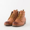 Lace-up boots in camel brown burnished leather with rubber sole