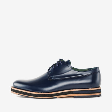 Classic design derby shoes in navy blue leather with a chunky build and contrasting beige sole
