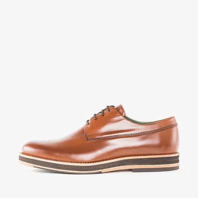 Classic design derby shoes in cognac brown leather with a chunky build and contrasting beige sole