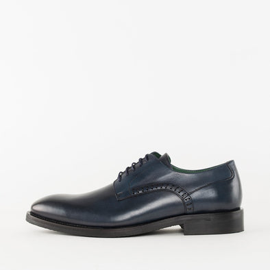 Formal derby shoes in polished navy blue leather, with simple side stitching details