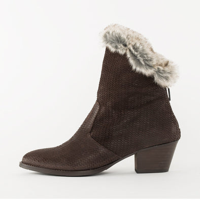 Low heeled medium length boots with na asymmetrical cut, low comma heel and pointed toe design in nut brown scale-textured waxed suede and fur lining