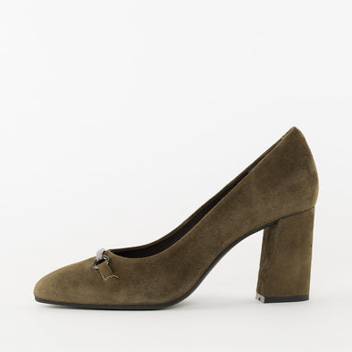 Minimalist pumps in olive green suede with a high block heel and metal applique on the toe