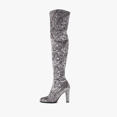 Over-the-knee boots with a high heel in shimmering grey velvet with a barroque-motif texture