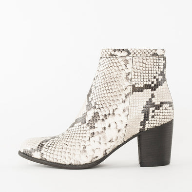 High-heeled ankle boots in white and black patterned snake-textured leather with block heel