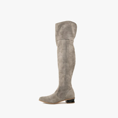 Minimalist over-the-knee boots in grey suede with side ziper and faceted black low heel