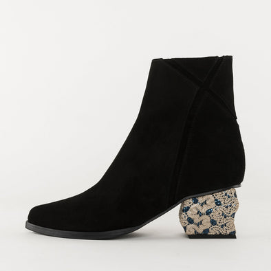 Pointed toe slim ankle boots in black suede with X-shaped detail on the shaft, medium geometric heel in deep blue glitter covered in nude lace