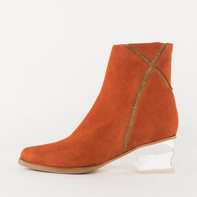 Pointed toe slim ankle boots in orange suede with X-shaped glittery detail on the shaft, medium geometric transparent heel