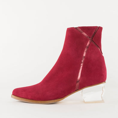 Pointed toe slim ankle boots in red suede with shimmery X-shaped detail on the shaft, medium geometric transparent heel