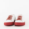 Low top lace-up sneakers in white leather with red laces and red rubber sole