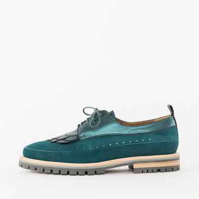 Derby shoes in aquamarine green suede, with perforation and stitching details across the body, metallic leather panels, petal-shaped fringe and contrasting beige track sole