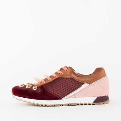 Runners in a combination of bordeaux suede and leather, brown leather and millenial pink fur with golden metal embellishments on the toe